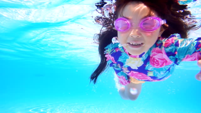 little girl swimming in pool blue water - water sport stock videos & royalty-free footage