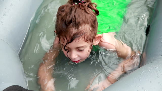 little girl swimming in the childs pool - reclining stock videos & royalty-free footage