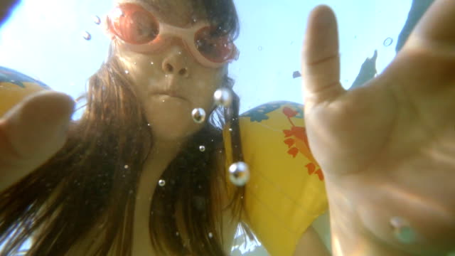 little girl swimming underwater - swimming goggles stock videos & royalty-free footage
