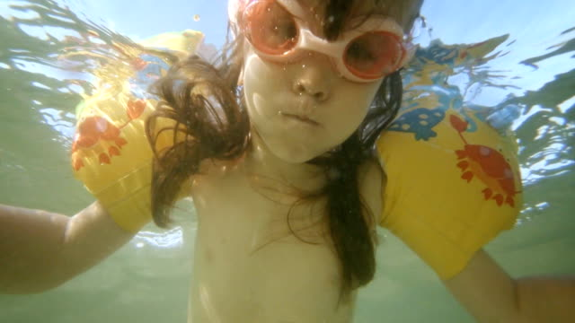 little girl swimming underwater - swimming shorts stock videos & royalty-free footage