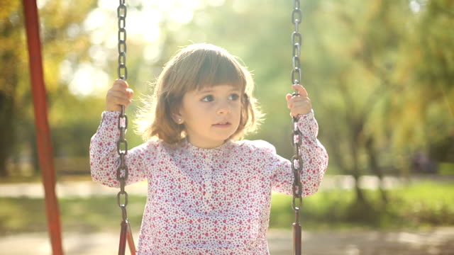 little girl swinging in a park - swing stock videos and b-roll footage