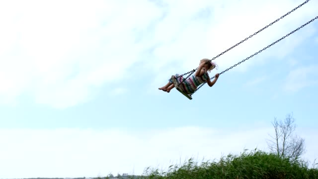 little girl swinging on a wooden swing - swinging stock videos & royalty-free footage