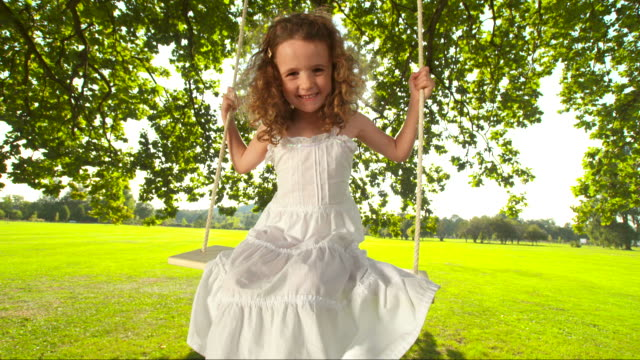 HD SLOW MOTION: Little Girl Swinging On Tree Swing