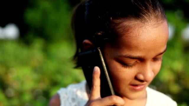Little girl talking on Smartphone