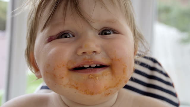 Little Girl Toddler Messy Eating In High Chair