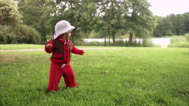A little girl toddling around Stockholm Sweden.