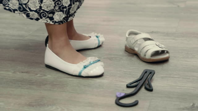 little girl trying on shoes in store - footwear stock videos & royalty-free footage
