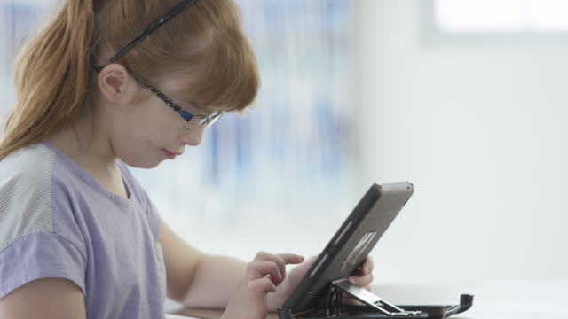 little girl using a digital tablet - visual impairment stock videos & royalty-free footage