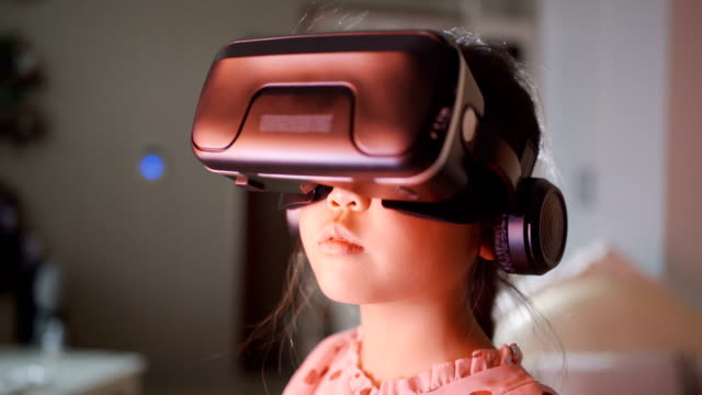 little girl using a virtual reality glasses at home - electrical equipment stock videos & royalty-free footage