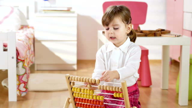 hd dolly: little girl using an abacus - group of objects stock videos & royalty-free footage