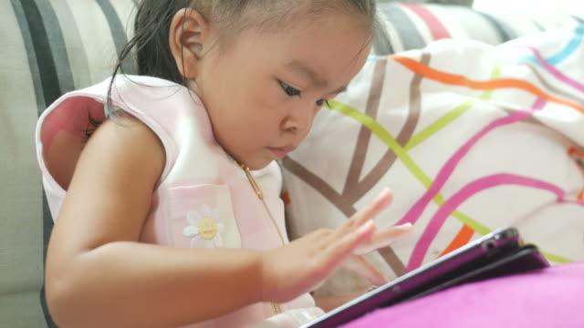 little girl using digital tablet - school child stock videos & royalty-free footage