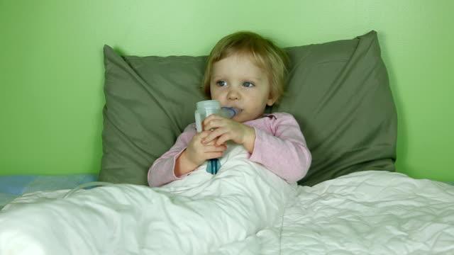 Little girl using inhaler / nebulizer
