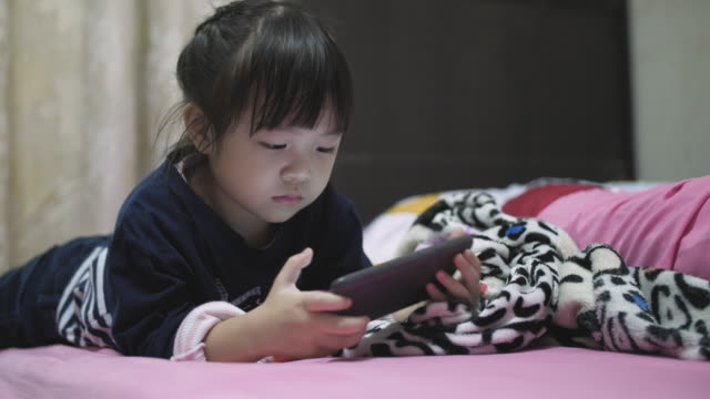 little girl(4-5 years) using phone - 4 5 years stock videos & royalty-free footage