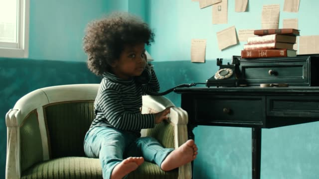 little girl(2-3 years) using rotary phone - telephone dial stock videos & royalty-free footage