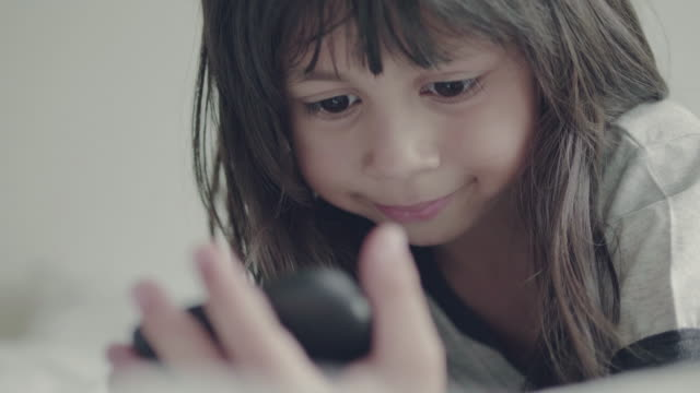little girl (5 years) using smart phone at home - childhood stock videos & royalty-free footage