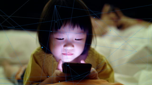 little girl(4-5 years) using smartphone with communication network at night - 4 5 years stock videos & royalty-free footage