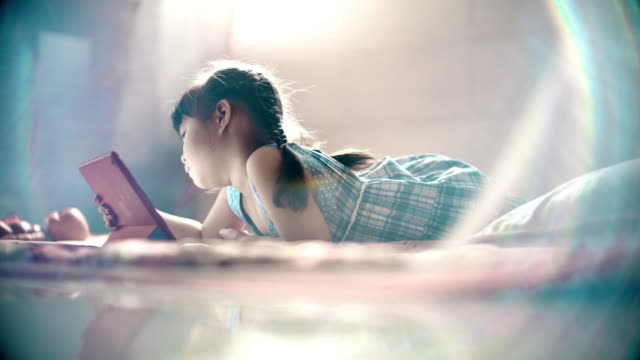 little girl using tablet in the bedroom - east asia stock videos & royalty-free footage
