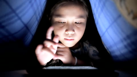 little girl using tablet under the blanket - dolly shot stock videos & royalty-free footage