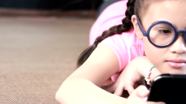 little girl using tablet - leisure games stock videos & royalty-free footage