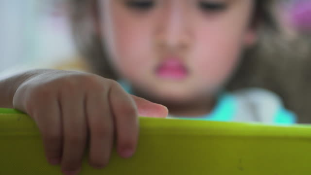 little girl using with a digital tablet,close-up - refugee stock videos and b-roll footage