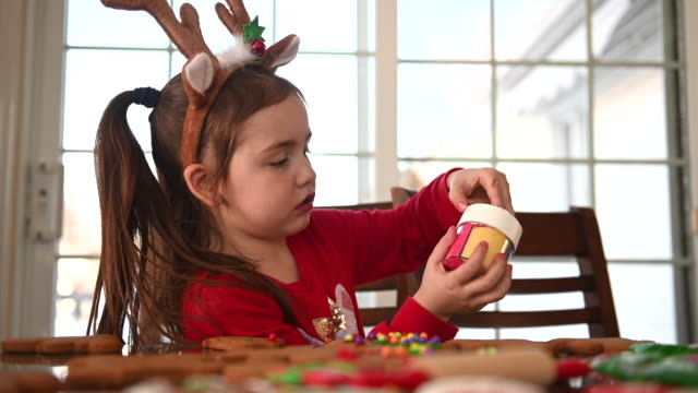 little girl vlogging how to decorate christmas cookies - 6 7 years stock videos & royalty-free footage