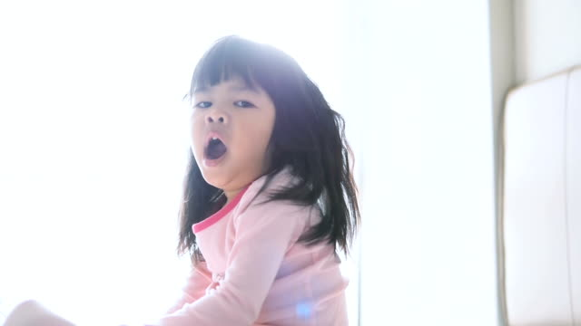 little girl waking up - yawning stock videos & royalty-free footage