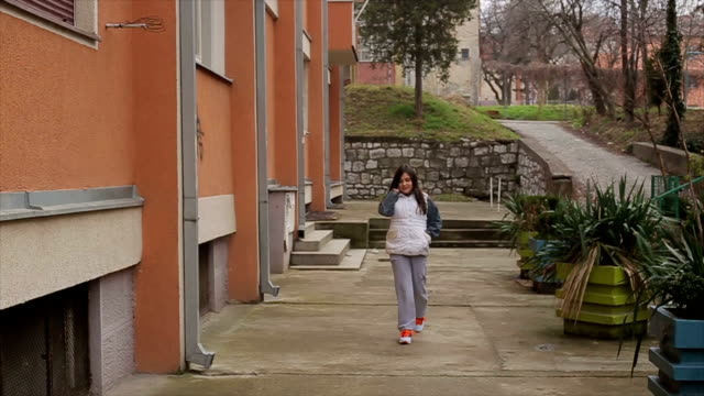 Little girl walking and talking with smart phone