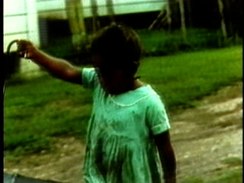 little girl walking barefoot in mud with umbrella/ usa - puddle stock videos & royalty-free footage