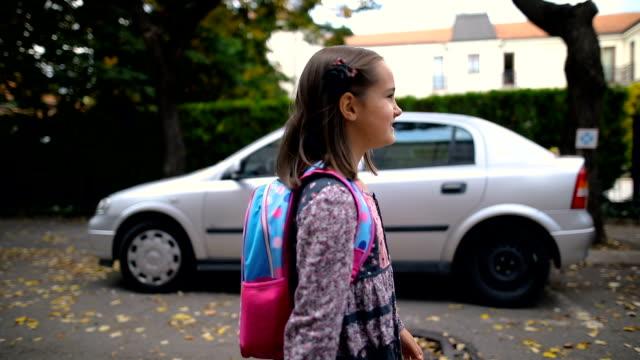 little girl walks to school - satchel stock videos & royalty-free footage