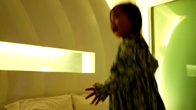 little girl was jumping on the bed having fun. - nursery bedroom stock videos & royalty-free footage