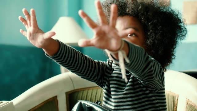 little girl waving hand say hi - hanging up stock videos & royalty-free footage