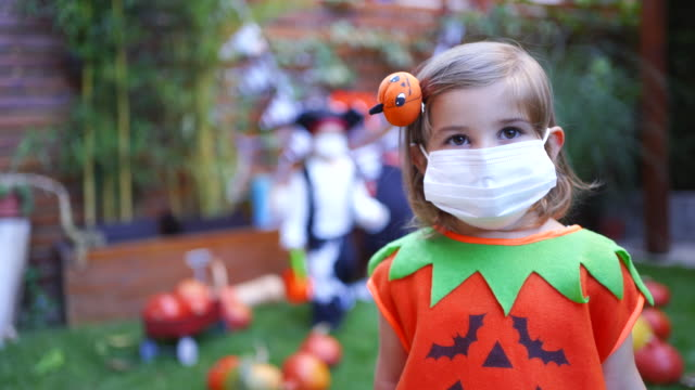 little girl wearing face mask on halloween party during covid-19 pandemic - spooky stock videos & royalty-free footage
