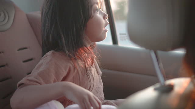 little girl while traveling with her family - comfortable stock videos & royalty-free footage