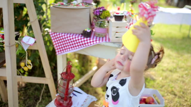 little girl wiht a party hat - birthday stock videos and b-roll footage