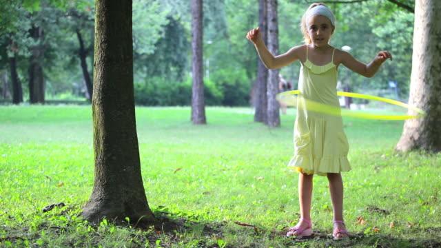 little girl with a hula hoop - plastic hoop stock videos & royalty-free footage