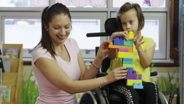 little girl with cerebral palsy - cerebral palsy stock videos & royalty-free footage