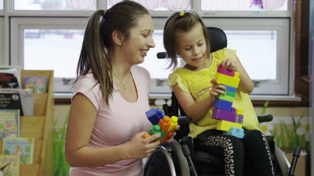 little girl with cerebral palsy - wheelchair stock videos and b-roll footage