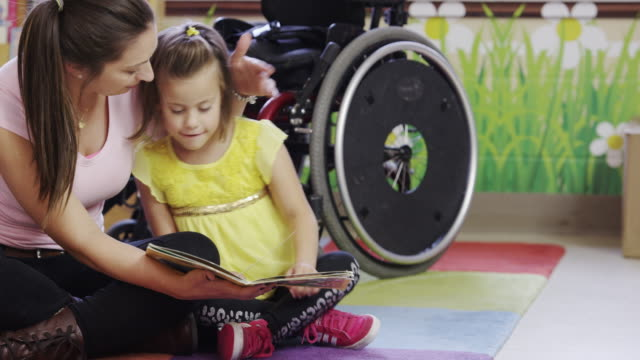 little girl with cerebral palsy - physical disability stock videos & royalty-free footage