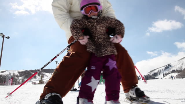 ms little girl with dad and extended family skiing / park city, utah, united states - park city stock videos & royalty-free footage