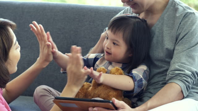 little girl with down syndrome high-five with her mother - 2 3 years stock videos & royalty-free footage