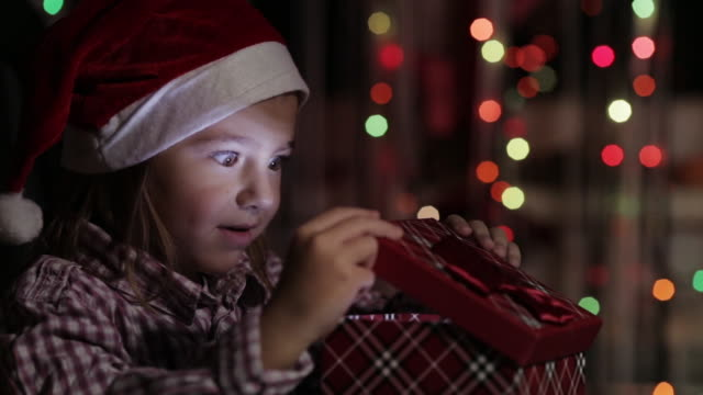little girl with gift - christmas gift stock videos & royalty-free footage