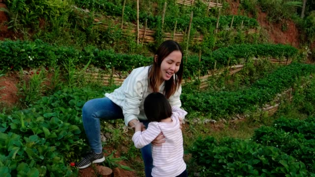 little girl(2-3 years) with her mother enjoyment at the strawberry farm - 2 3 years stock videos & royalty-free footage