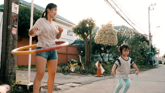 little girl with her mother jumping rope and playing hula-hoop - competitive sport stock videos & royalty-free footage