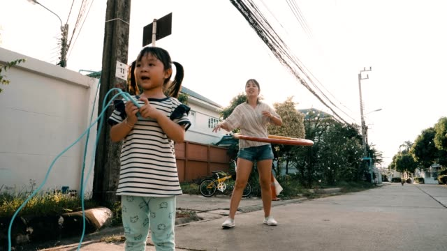 little girl with her mother jumping rope and playing hula-hoop - jump rope stock videos & royalty-free footage