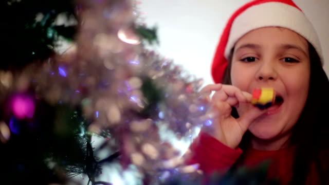 little girl with horn blower