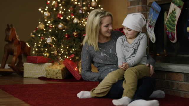 little girl with leukaemia cancer at christmas with mother - completely bald stock videos & royalty-free footage
