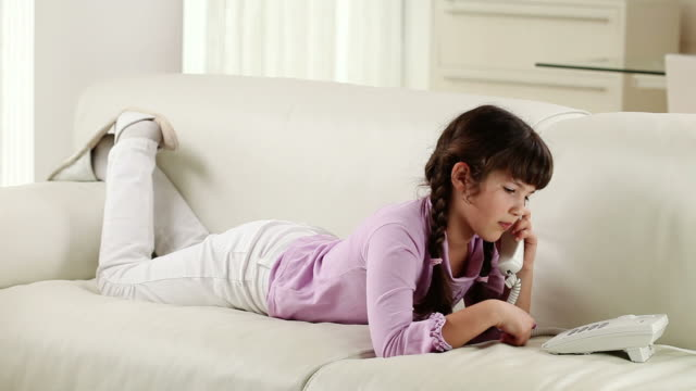 little girl with telephone. - landline phone stock videos and b-roll footage