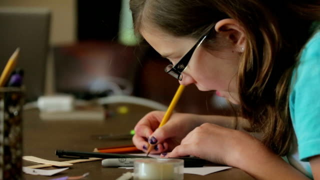 little girl working on craft project. - writing instrument stock videos & royalty-free footage