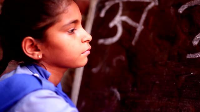 little girl writing on blackboard - lavagna video stock e b–roll