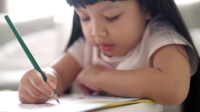 little girl writing on drawing book at home , slow motion - the alphabet stock videos & royalty-free footage